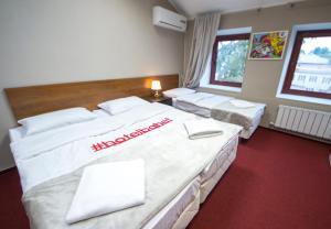 Кровать или кровати в номере Отель Бахет