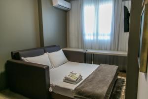 A seating area at Interclass Hotel Criciuma