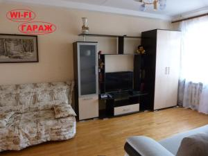 A television and/or entertainment center at Apartment in Centre on Andreya Gubina