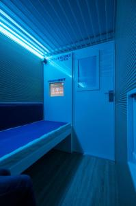 A bed or beds in a room at ZZZleepandGo BGY