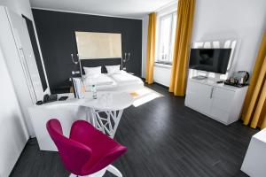A television and/or entertainment center at Hotel Sinsheim
