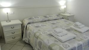 A bed or beds in a room at Valle Rillo Agriturismo