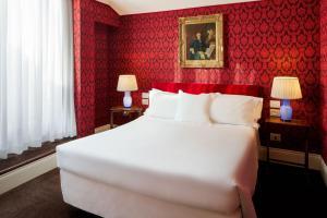 Кровать или кровати в номере Grand Hotel Duchi d'Aosta