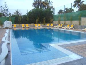 Het zwembad bij of vlak bij Bungalows Rebecca Park
