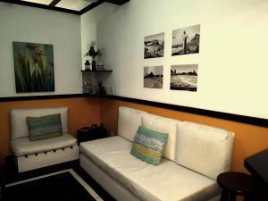 Uma área de estar em Apartamento Aconchegante Quadra da Praia