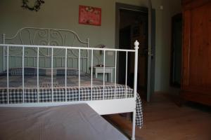 Letto o letti in una camera di La Colombara