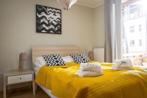 Łóżko lub łóżka w pokoju w obiekcie Mielno-Apartments Rezydencja Park Rodzinna