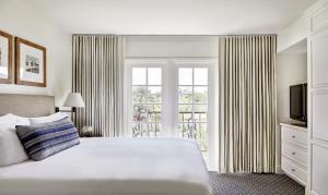 A bed or beds in a room at Arizona Grand Resort