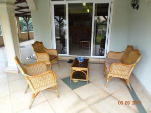 A seating area at Beau seaside villa