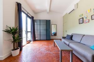 A seating area at Chez Nous - 7 Appartements sur le Vieux Port