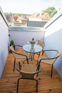 A balcony or terrace at Apartmány u sv. Kryštofa