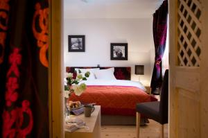 A bed or beds in a room at CGH Résidences & Spas Le Lodge Hemera