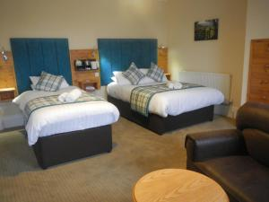 A bed or beds in a room at Burton Hotel