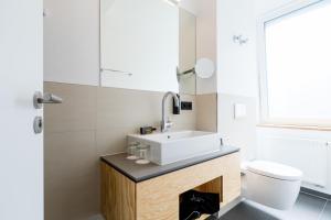 Ein Badezimmer in der Unterkunft mk | hotel münchen city