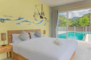 Кровать или кровати в номере Ao Nang Miti Resort