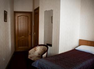 Кровать или кровати в номере Дом Достоевского