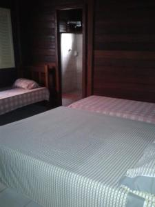 A bed or beds in a room at Residencial do bosque