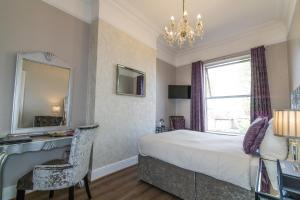 A bed or beds in a room at Charleville Lodge Hotel