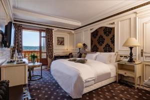 A bed or beds in a room at Michlifen Resort & Golf