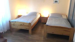 Ein Bett oder Betten in einem Zimmer der Unterkunft Gasthof Haus Bleich