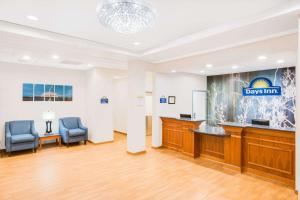 The lobby or reception area at Days Inn by Wyndham Evans Mills/Fort Drum
