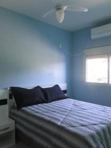 Cama ou camas em um quarto em Pousada Praia da Villa
