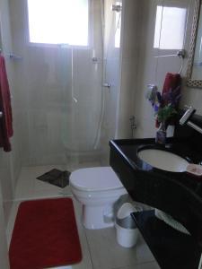 Um banheiro em Pousada Praia da Villa