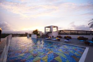 The swimming pool at or near Hue Hotels and Resorts Puerto Princesa Managed by HII