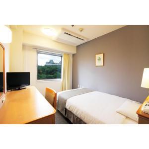 Tempat tidur dalam kamar di Smile Hotel Wakayama
