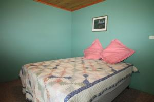 A bed or beds in a room at South Sussex's Blue Cottage