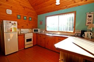 A kitchen or kitchenette at South Sussex's Blue Cottage