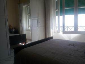 A bed or beds in a room at Casa Vista Mare