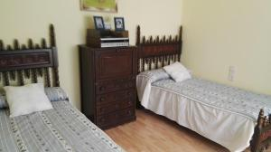 A bed or beds in a room at Casa Rustica Neiro