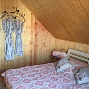 Кровать или кровати в номере Usadba Perepêlkino