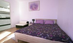 Łóżko lub łóżka w pokoju w obiekcie Apartamenty na pięterku