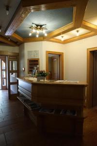 Lobby/Rezeption in der Unterkunft Garni Hotel Wildanger