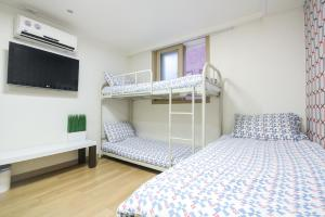 A bunk bed or bunk beds in a room at Zaza Backpackers hostel