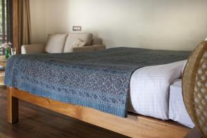 A bed or beds in a room at Tall Trees Resort by OpenSky