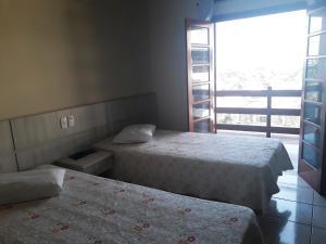 Cama ou camas em um quarto em Cristal Palace Hotel