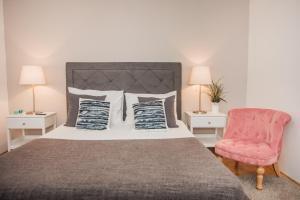 Łóżko lub łóżka w pokoju w obiekcie Hostel Splendido