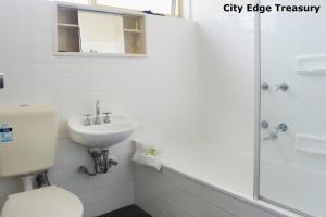 A bathroom at City Edge East Melbourne Apartment Hotel