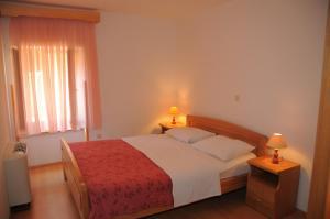 A bed or beds in a room at Villa Radovan