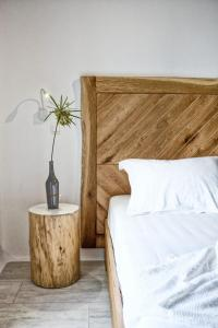 A bed or beds in a room at Orkos Beach Hotel