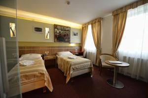 Кровать или кровати в номере Hotel Vaka