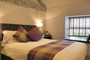 A bed or beds in a room at Healds Hall Hotel