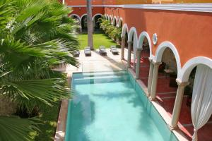 A view of the pool at Hotel Hacienda Mérida or nearby