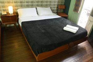 A bed or beds in a room at Splendido Hotel