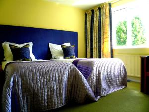 A bed or beds in a room at Malvern House