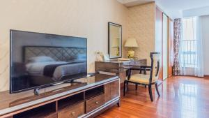 A television and/or entertainment center at The Legend Nuomo Service Apartment