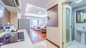 A kitchen or kitchenette at The Legend Nuomo Service Apartment